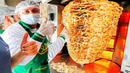 迪拜最大旋转烤肉,足足有100公斤,需要4个人抬,看看100多元能在这里吃些啥呢?