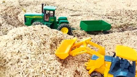 农场里工程车施工,四轮拖车,装载车,耙地机