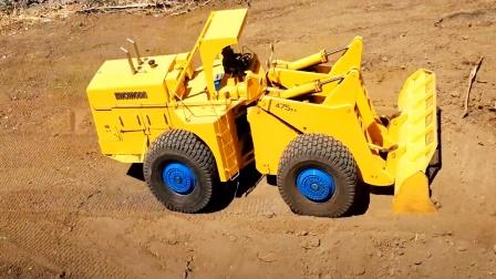 遥控工程车,一辆黄色装载车整理路面铺路