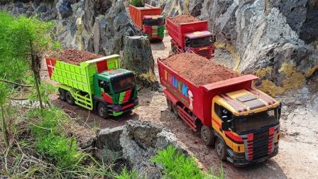 工程车大卡车玩具运输货物在山间小路行驶