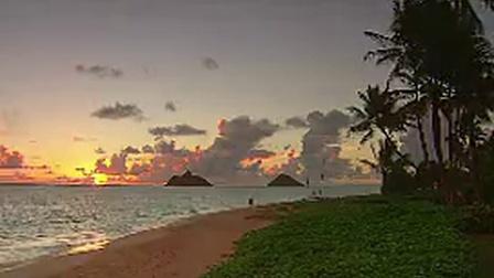 X001朝阳下的海岸波光鳞鳞海面