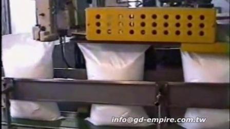 大米自动套袋机,饲料全自动包装机--安徽精益精