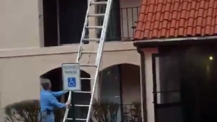 Firefighters_rescue_a_man_trapped_on_a_third_floor_balcony___firefighting