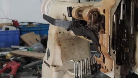 永滔床垫机械8B围边机头更换针杆的方法