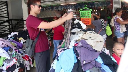 CIA志愿者活动--日本经理在帮孤儿院小孩挑选衣服