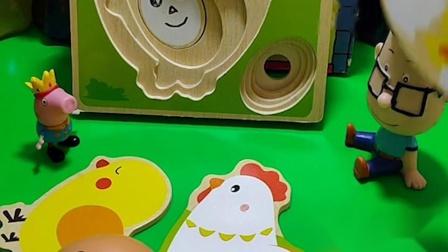 乔治带着小鸡玩具和大头儿子玩,大头儿子不喜欢小鸡玩具,小头爸爸送给了乔治糖果