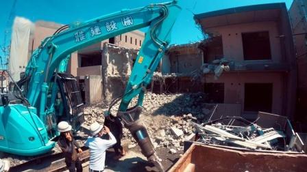 拆楼钢鉄筋卸下来,神钢挖掘机