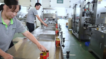 人手袋包装入罐-自动封罐  广州市方圆机械设备有限公司