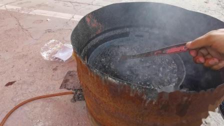 诸城中医传统黑膏药材香油提取过程实录