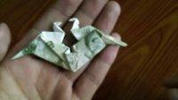 如何用一张人民币折一对kiss千纸鹤 折纸王子