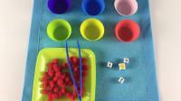 幼儿园趣味数学游戏,按颜色分类夹豆子游戏