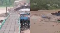 四川暴雨致1.4亿在建大桥坍塌,目击者拍下洪水吞没桥体瞬间