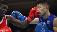 奥运骗局!日本选手被打到躺轮椅吸氧仍判赢?哥伦比亚网民怒了!