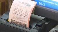男子用别人号买彩票中1067万:不告诉家人