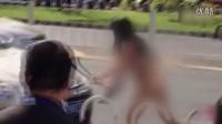 北京街头裸女疯狂打砸过往车辆 强拆车牌