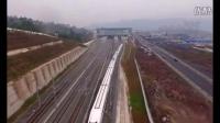 渝万高铁震撼航拍,动车组如银色巨龙穿越高架隧道!