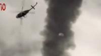 实拍:直升机大摇大摆过龙卷风 被吸入坠毁
